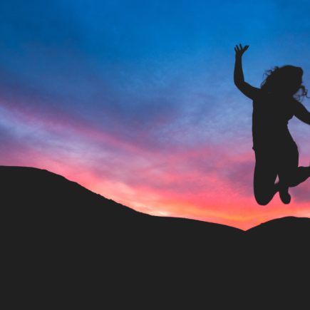 silhouette of person jumping during dawn